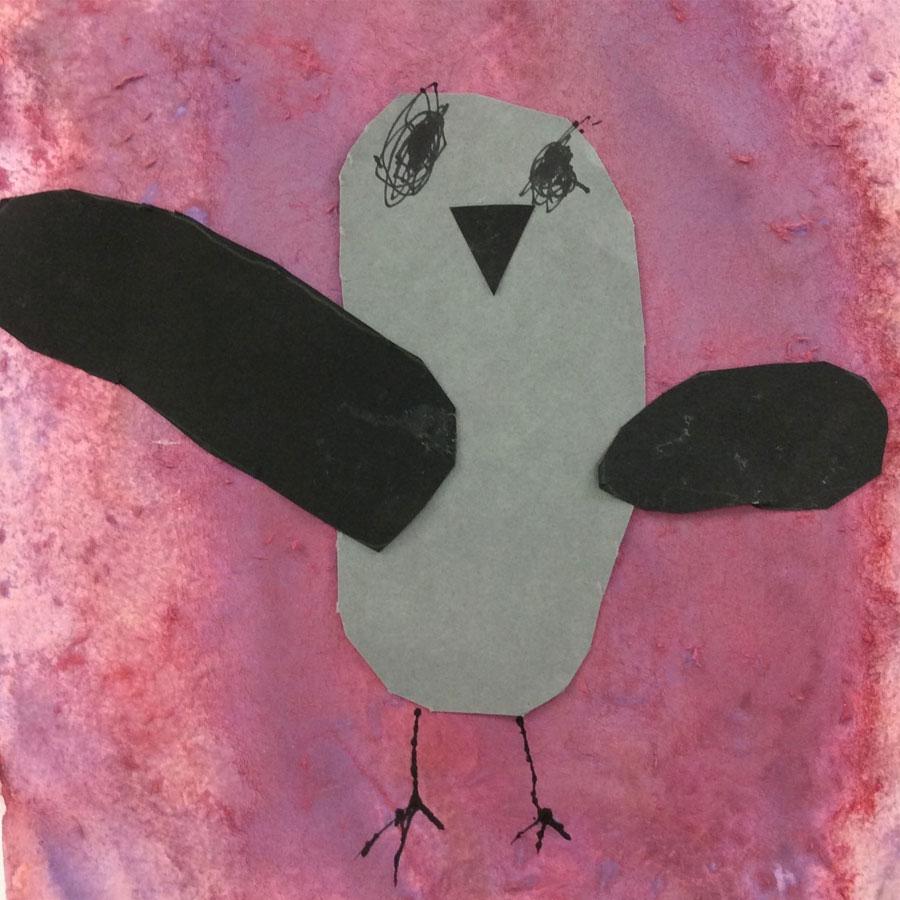 Lapsen askartelema lintukortti.
